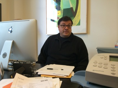 Zyzzyva's managing editor Oscar Villalon takes a break from reading manuscripts at the journal's offices in downtown San Francisco. Photo by Jeanne Carstensen for KQED.