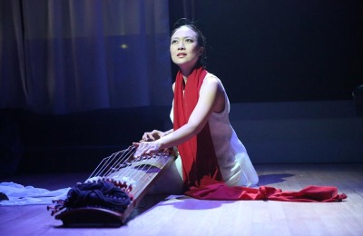 Jen Shyu presents impressions of her travels through Taiwan, East Timor, Indonesia, Vietnam, and South Korea in a new musical production. (Photo: Steven Schreiber)