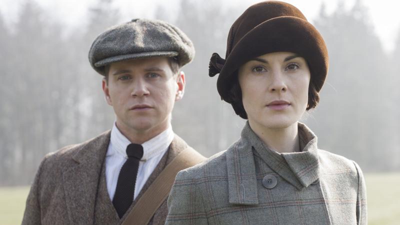Allen Leech as Tom Branson and Michelle Dockery as Lady Mary.