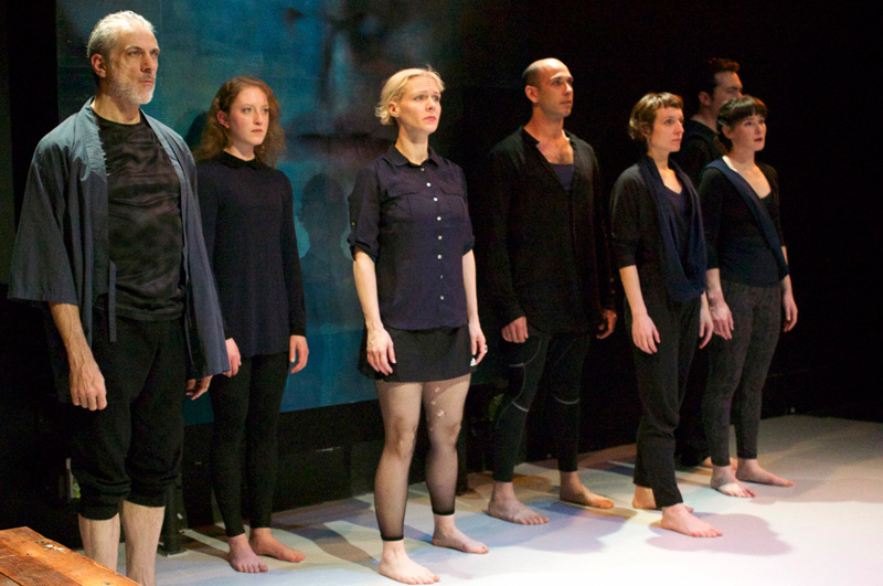 The chorus (l-r, Paul Loper, Hannah Donovan, Madeline H.D. Brown, Wiley Naman Strasser, Emma Crane Jaster, Elissa Beth Stebbins, Tim Green) regards Kreon's edict in Cutting Ball Theater's Antigone. (Photo: Chase Ramsey)