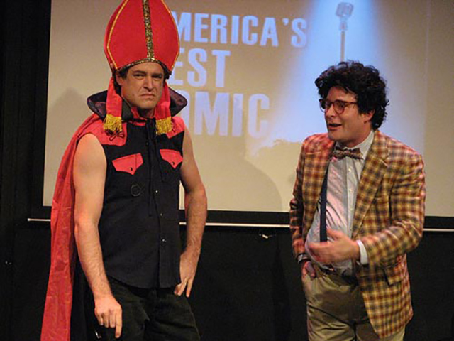 """Matt Besser as """"The Pope"""" onstage with James Adomian"""