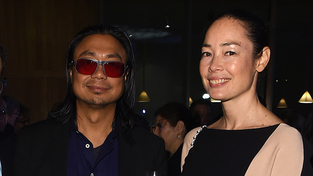 Rirkrit Tiravanija (left) and guest attend the the New York Times International Luxury Conference Gala at Perez Art Museum Miami. (Photo: Larry Busacca/Getty Images for The New York Times International Luxury Conference)