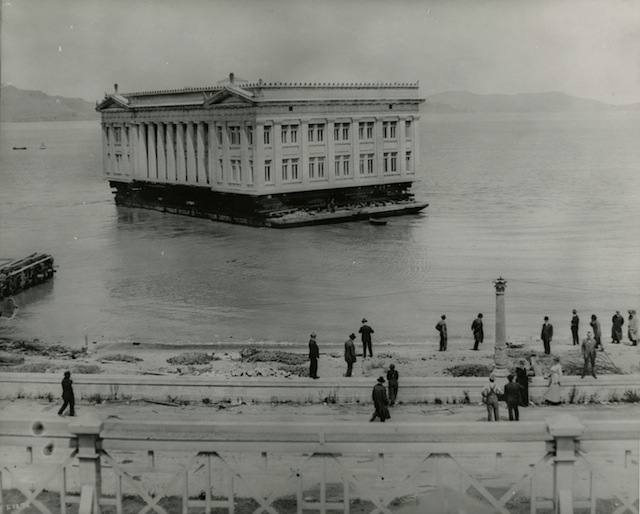 Deconstruction of the Panama-Pacific International Exposition - Ohio Building being floated to Coyote Point, 1916. Courtesy California Historical Society.