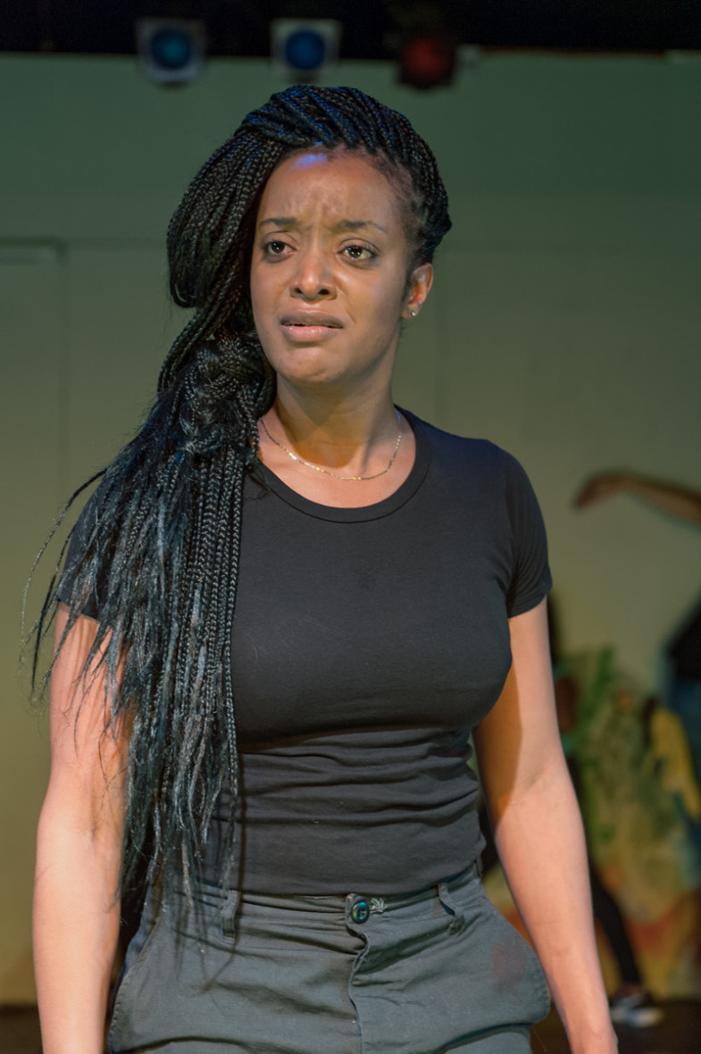 Tigs (Ryan Nicole Peters) defies Mayor Marcellus' law by unearthing the truth of the city's gun violence in African-American Shakespeare Company's Xtigone. (Photo: Lance Huntley)