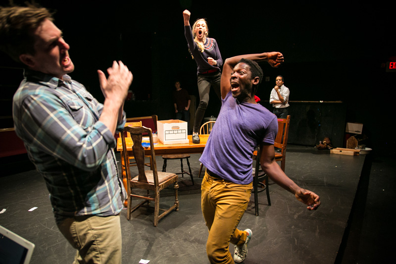 Another White Man (Patrick Jones), Sarah (Megan Trout) and Another Black Man (Rotimi Agbabiaka) improvise a fight.