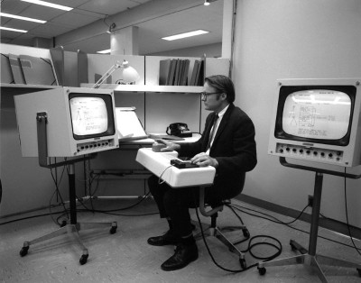 Bill English, Engelbart's lead engineer, testing the first mouse.