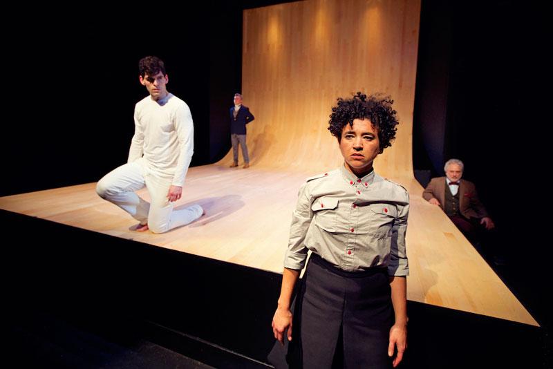 Antigone (Rami Margron) accepts Kreon's (Kevin Clarke) sentence of death, as Nick (Parker Murphy) and the Chorus (David Sinaiko) watch. (Photo: Pak Han.)