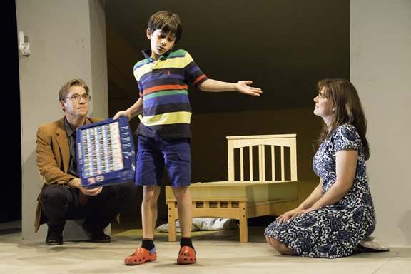 Max (Jonah Broscow) teaches his parents (Teddy Spencer and Elise Youssef). (Photo: Mark Palmer)