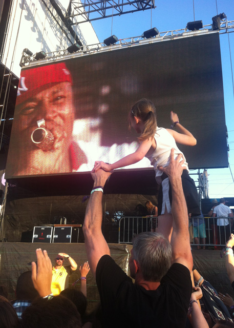 A young girl on her dad's shoulders watching L.L. Cool J at BottleRock 2014