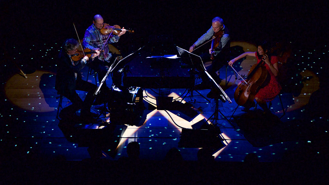 The Kronos Quartet (David Harrington, John Sherba, Hank Dutt, Sunny Yang) perform Terry Riley's 'One Earth, One People, One Love' at Miner Auditorium on June 26, 2015.