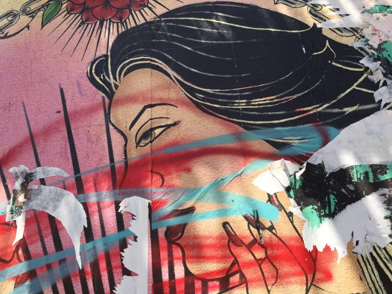One of the women on the defaced mural at Galeria de la Raza