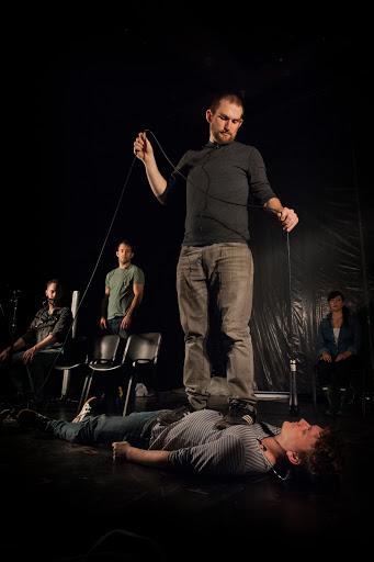 (L to R): Denis Butkus, Ryan Conarro, Justin Nestor (standing), Adam Cochran (lying down), Aysan Celik. Photo courtesy of Theater Mitu