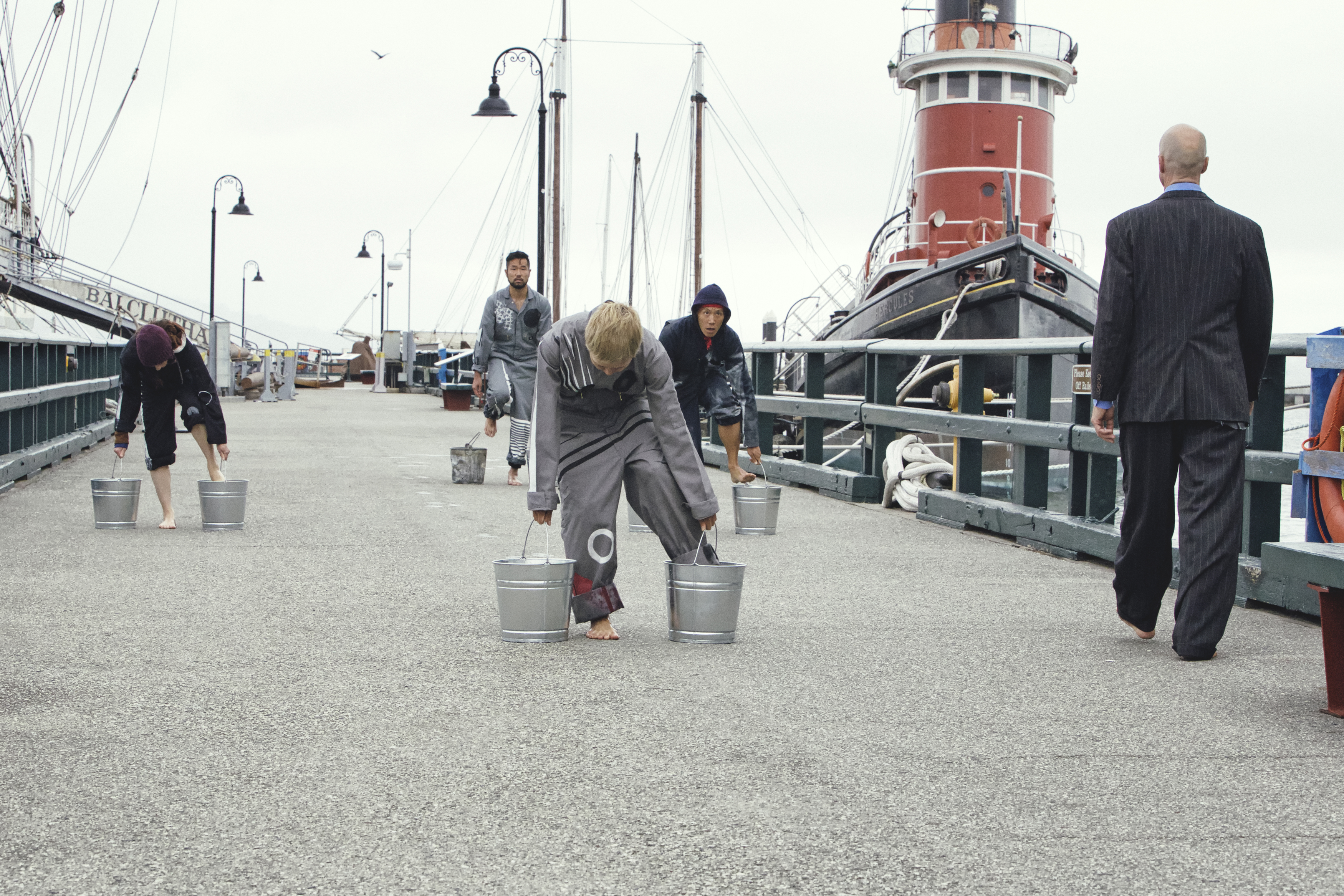 """Water Print"" dancers leaving wet footprints on the pier. Left to right: Dana Iova-Koga, Yoshi Asai, Yuko Kaseki, Sherwood Chen, Sten Rudstøm."