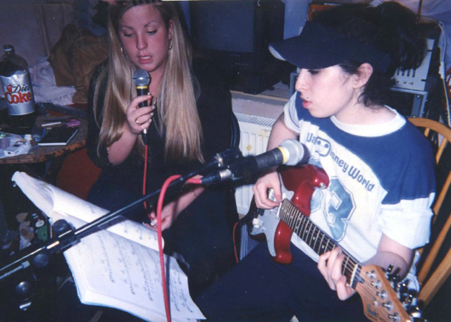 A young Amy Winehouse plays the guitar in the film 'Amy.' (Photo: A24 Films)