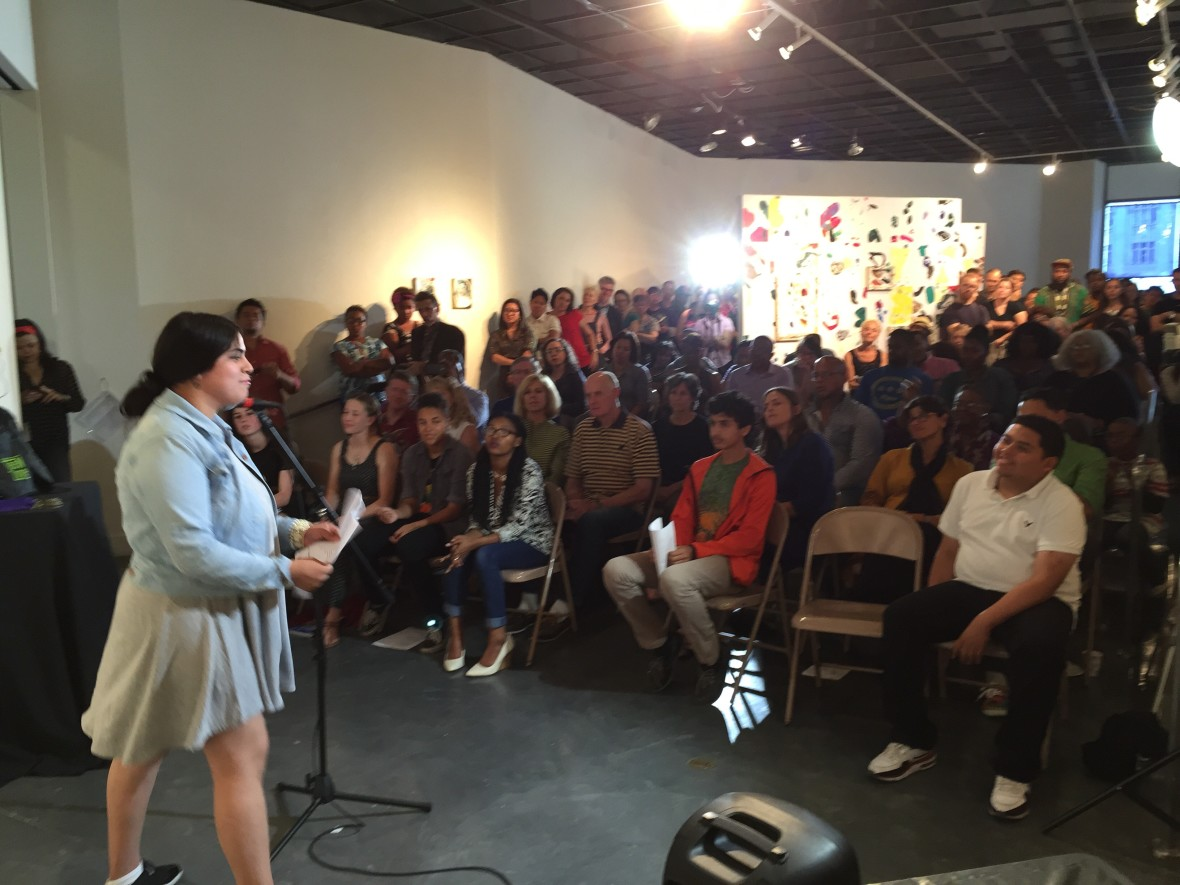 16 year old Litzy Castillo, a student at MetWest High School, thrills the crowd with her poem