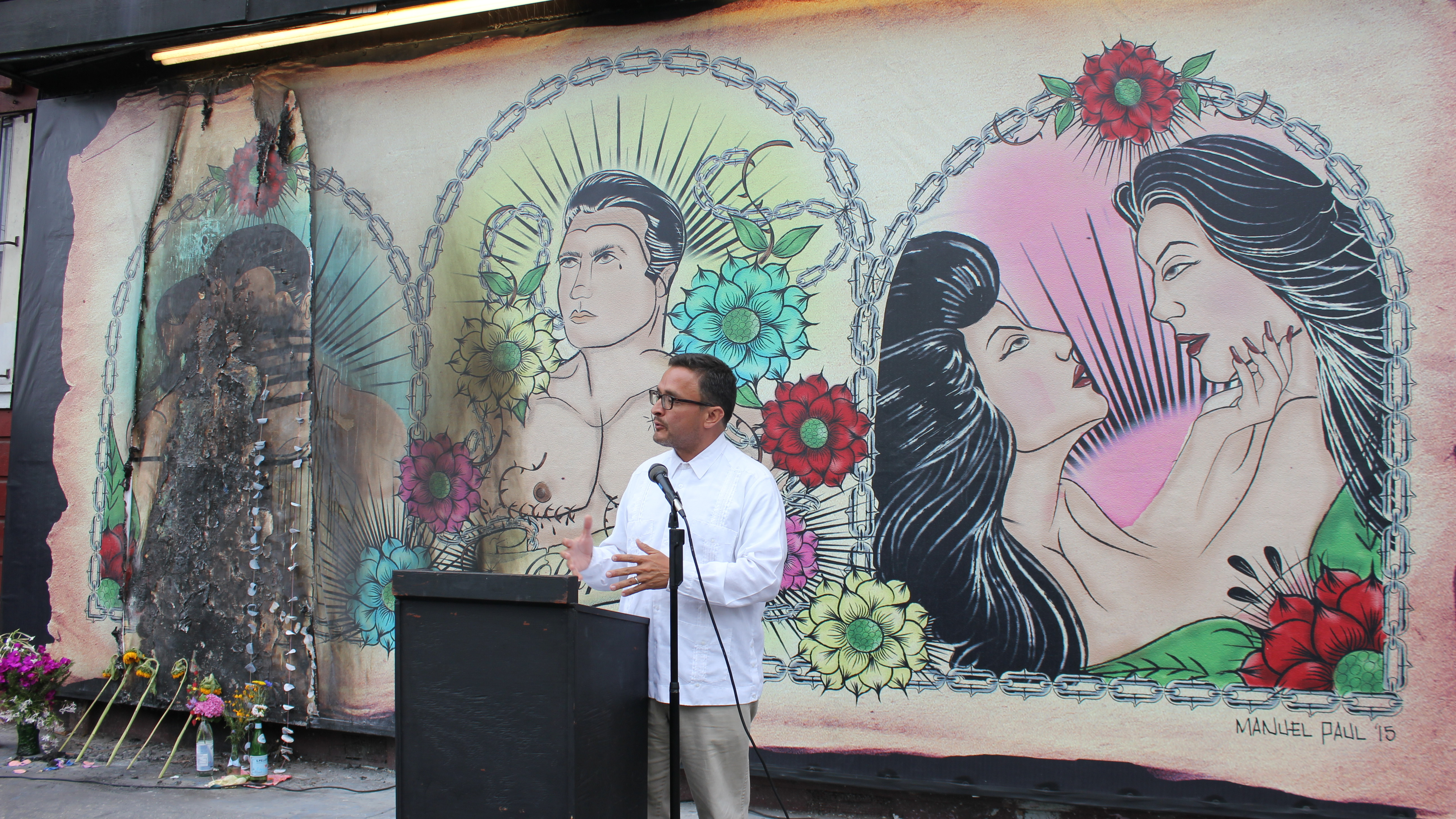 San Francisco Supervisor David Campos stands in front of the vandalized mural. (Photo by Jessica Placzek)