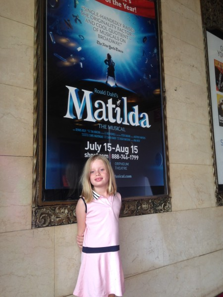 Rowan Kelly stands in front of a poster for 'Matilda the Musical' at the Orpheum Theatre in San Francisco