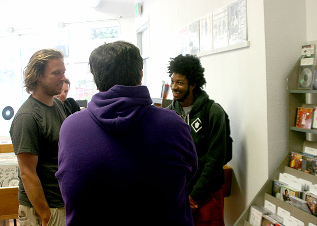 Andrew Nosnitsky, James Laurence and Squadda talk shop at Park Blvd. Records & Tapes in Oakland.