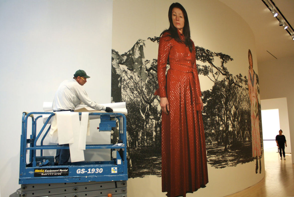 Charlene Tan, right, assesses a Cindy Sherman install at SFMOMA. (Photo courtesy SFMOMA)