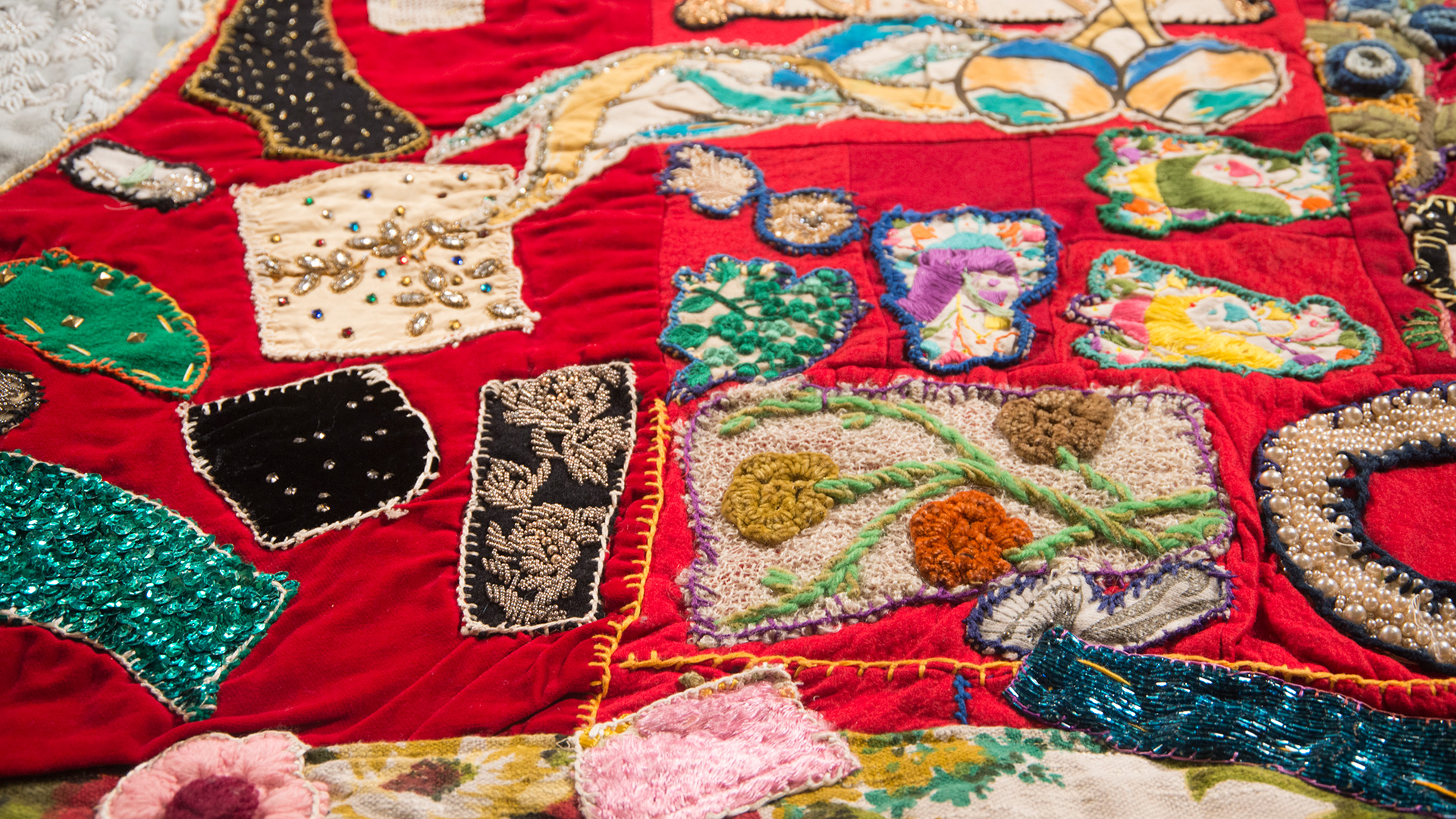 Pieced by Rosie Lee Tompkins, 'Unfinished (red velvet and embroidery)' (detail). (Photo: Terry Lorant/OMCA)