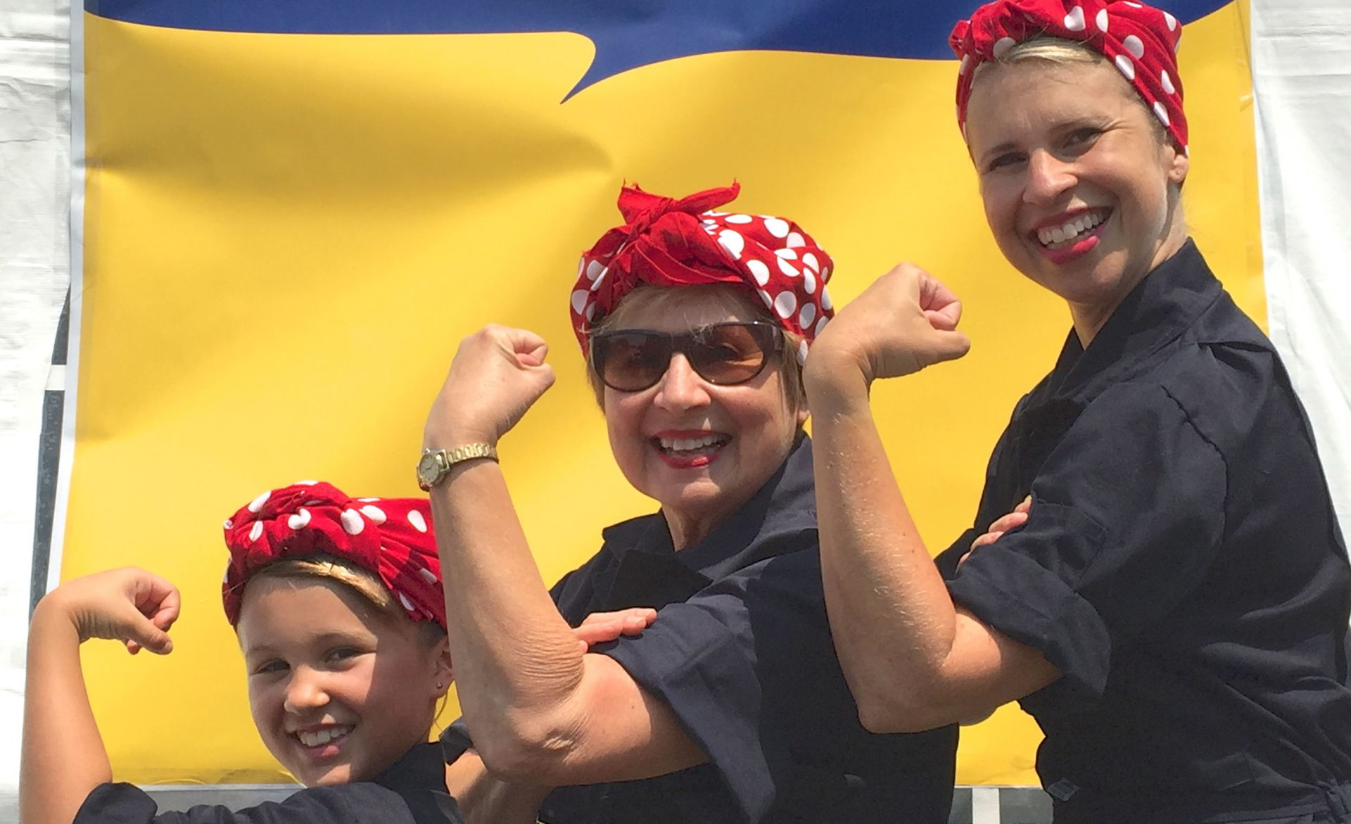 Julia, 9, Carol Burns, 71, and Jennifer Dolan, 43 at the Rosie the Riveter rally in Richmond, CA