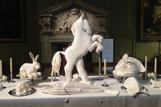 Though today we see these folded sculptures as simple decoration, 16th century guests would have been well aware of the symbolism behind each choice. These examples of napkin art were on display at Hampton Court Palace outside Londonin 2014