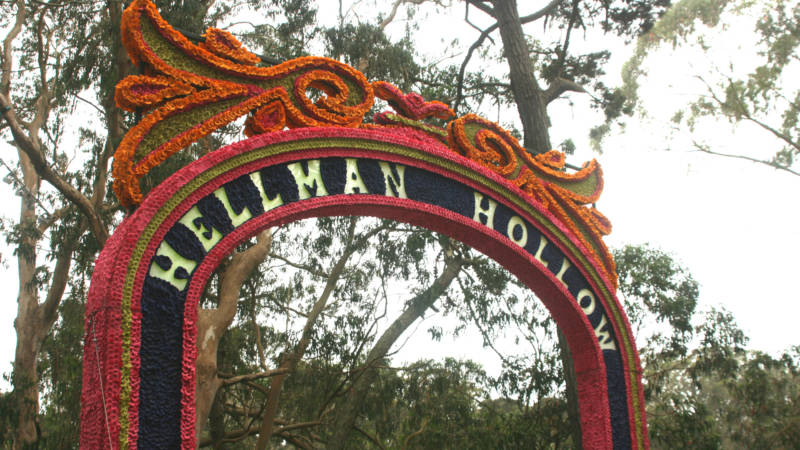 A sign honoring Hardly Strictly Bluegrass founder Warren Hellman at Outside Lands, Aug. 9, 2015. (Photo: Gabe Meline/KQED)