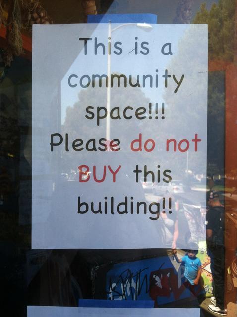 Sign in Precita Eyes' window at 348 Precita Ave. (Photo: Sarah Hotchkiss/KQED)