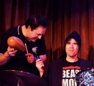 Tom Scharlping (L) and Jon Wurster (R) during a live performance