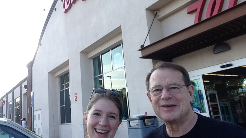 In the parking lot with my dad after purchasing my selfie stick. (Photo: Adrienne Blaine)