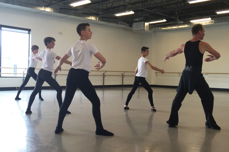 Ballet master John Gardner (right) leads an all-boys class at the Colorado Ballet in Denver.
