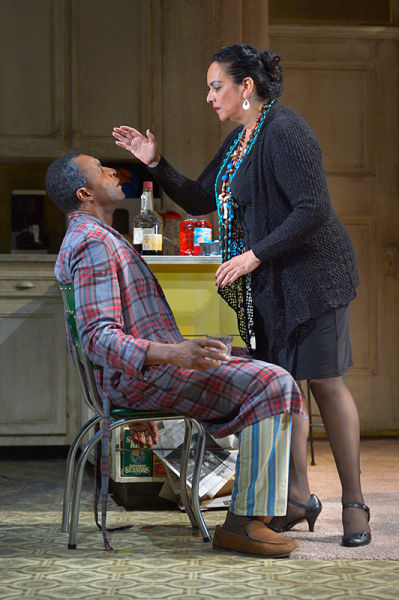 """The Church Lady (Catherine Castellanos) prays for Walter """"Pops"""" Washington (Carl Lumbly, left) in Stephen Adly Guirgis's Pulitzer Prize–winning dark comedy, Between Riverside and Crazy. Photo by Kevin Berne"""