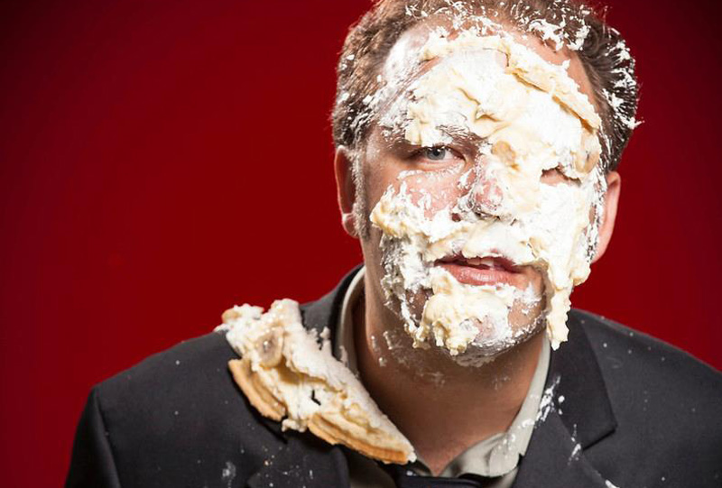 The author, after receiving a celebratory banana cream pie to the face