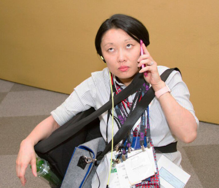 Christina White taking a business call between Dreamforce panels