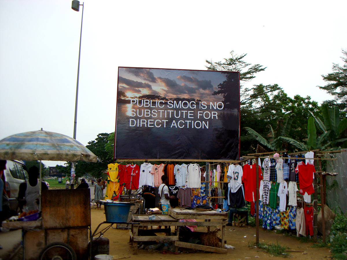 Amy Balkin, PUBLIC SMOG IS NO SUBSTITUTE FOR DIRECT ACTION, Billboard, Bonamoussadi, Douala, Cameroon, 2009.