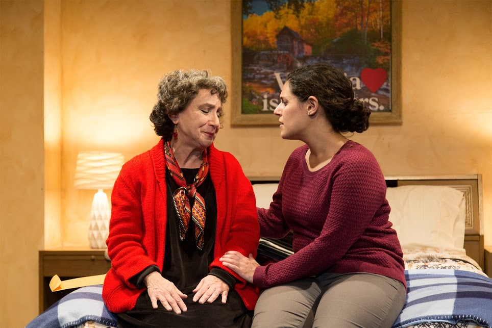 Ayelet (Roneet Aliza Rahamim, right) consoles her grandmother Edna (Roberta J. Morris) in a scene from 'Handle with Care.'
