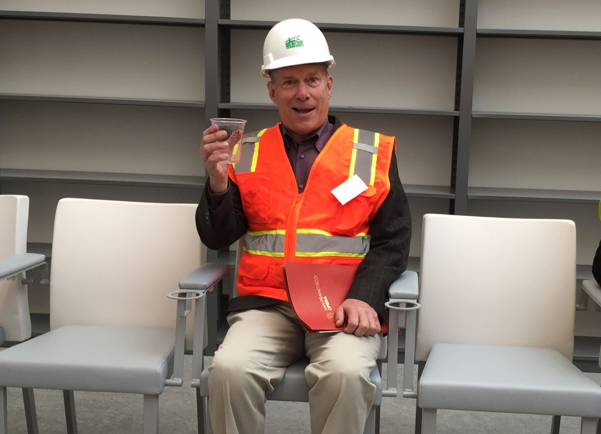 SF Opera General Director David Gockley testing out a seat for the new Taube Theater