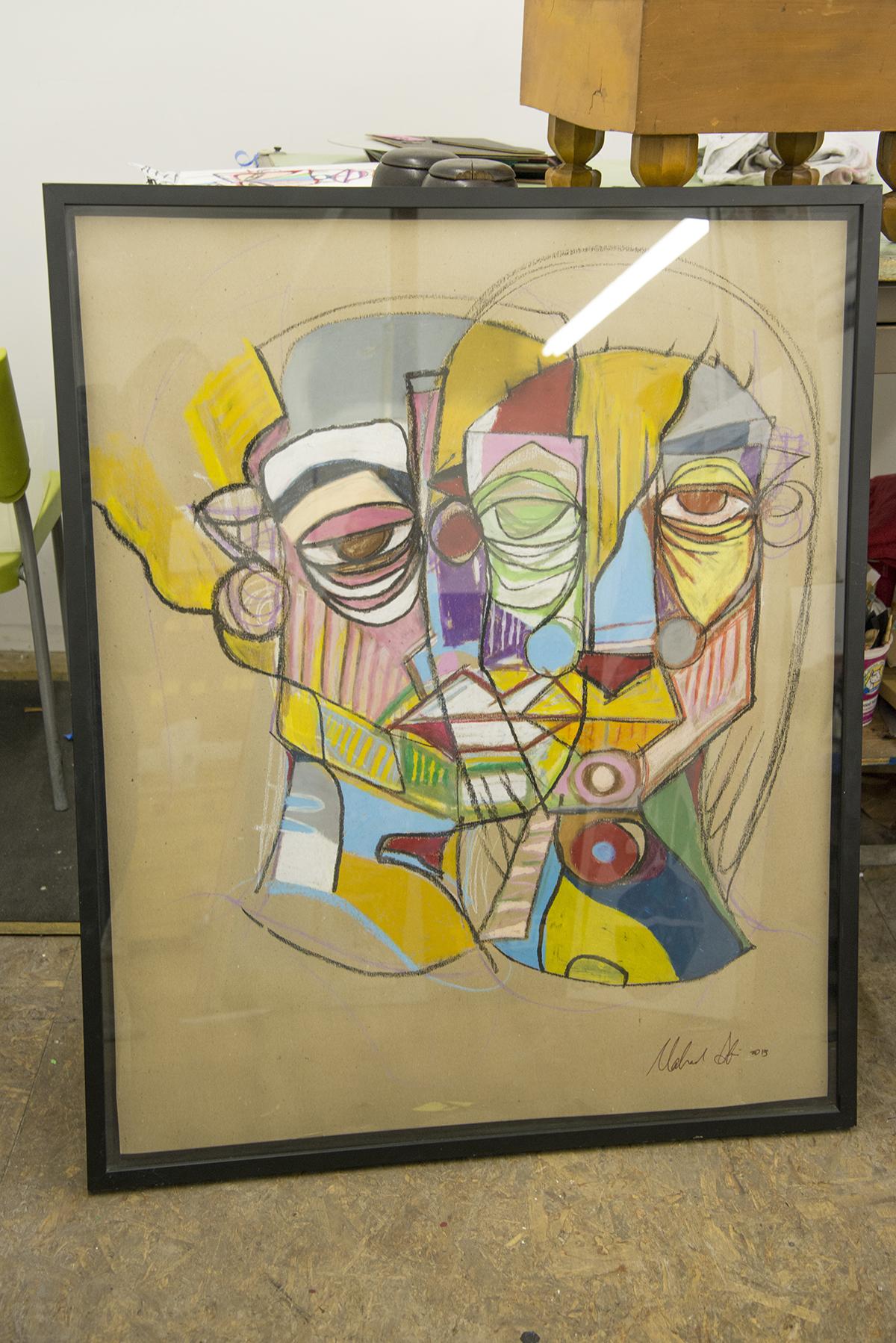 Framed work on paper in Tesfai's studio.
