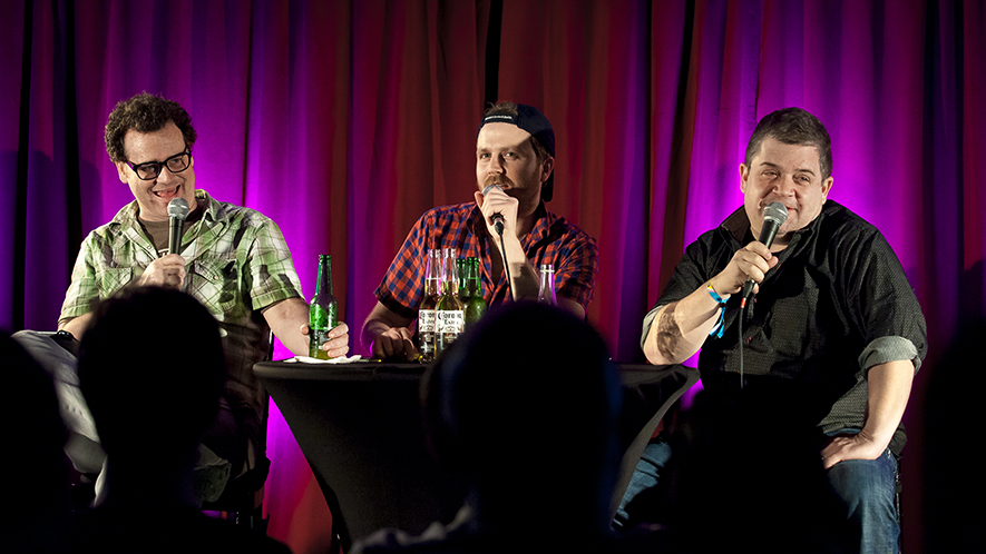 L to R: Dave Anthony, Gareth Reynolds and Patton Oswalt recording a live Dollop