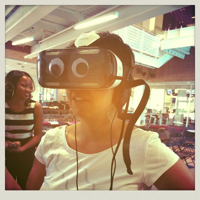 """Experimenting with various virtual reality headsets and experiences at """"Hack the Gender Gap: Women's Hackathon"""" event at USC Annenberg."""