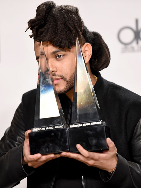 Recording artist The Weeknd, winner of Favorite Soul/R&B Male Artist and Favorite Soul/R&B Album, poses in the press room during the 2015 American Music Awards at Microsoft Theater
