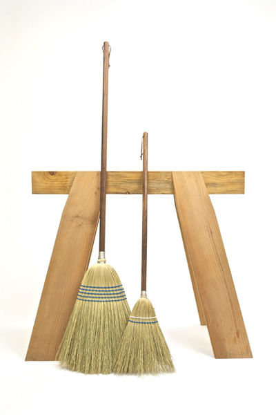 Adult and kid-sized brooms by Hannah Quinn.