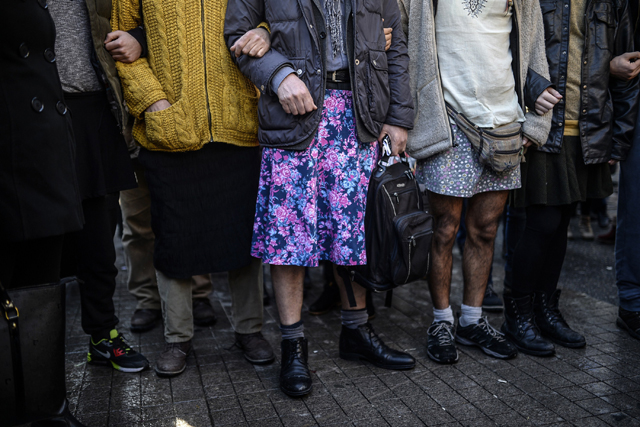 Turkish men wearing skirts demonstrate in Istanbul, to support women's rights in memory of 20-year-old Ozgecan Aslan.
