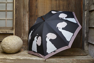 Banish rainy day blues with a clever and classy brellie.