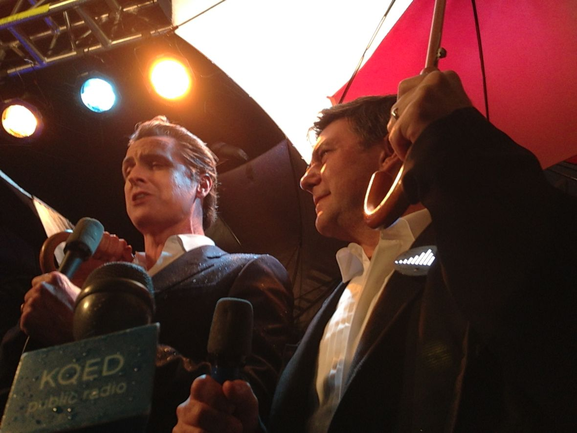 Lieutenant Governor Gavin Newsom (left) joined Leo Villareal to turn on the Bay Lights in March of 2013 under rainy skies