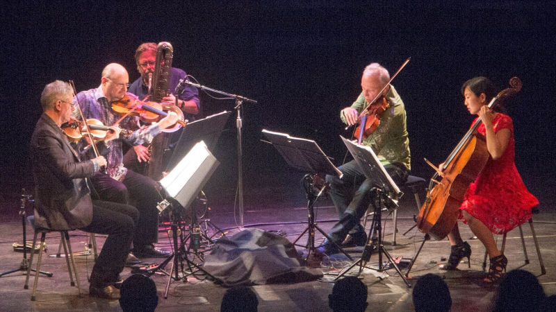 Ralph Carney (third from left) plays with the Kronos Quartet at the 2015 Cabrillo Festival of Contemporary Music in Santa Cruz