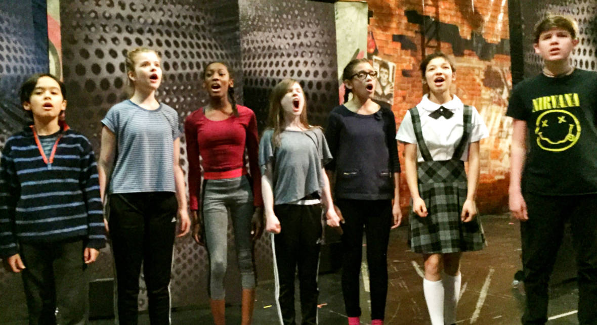 Oakland School for the Arts students rehearsing 'School of Rock' on the Curran Theater stage