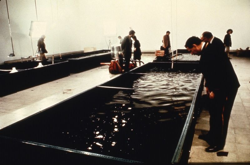 "People exploring the Harrisons' ""Portable Fish Farm"" installation in 1971"