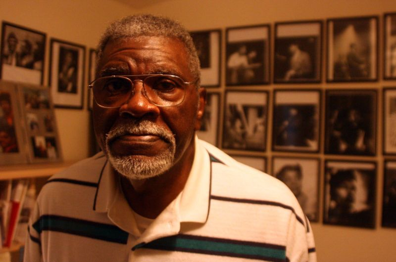 Elbert 'Big Man' Howard in his home in Santa Rosa in 2016; framed photos of jazz musicians line the walls.