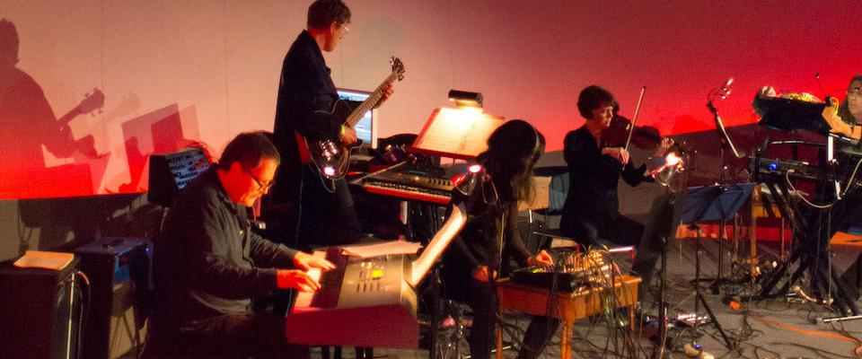 The Climate Music Project on stage at the Chabot Space & Science Center.